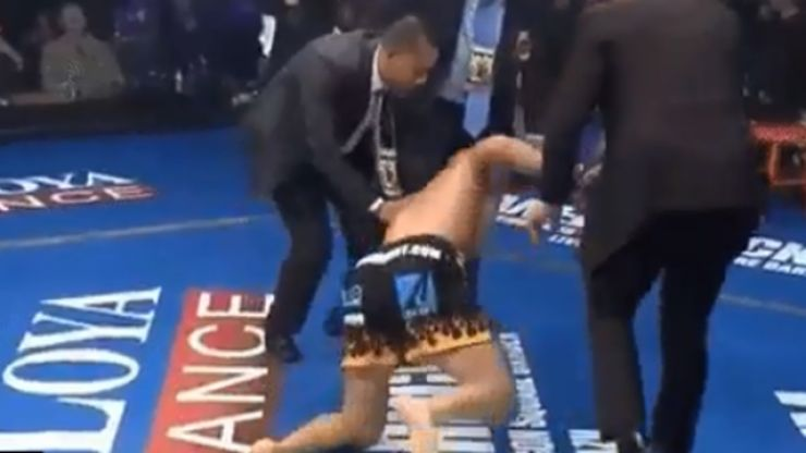 Officials attempt to stop Tito Ortiz's iconic celebration after knocking out Chuck Liddell