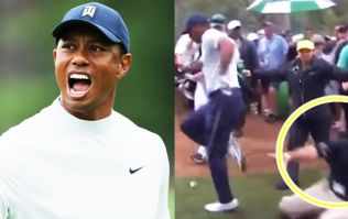 Security guards taking him out but Tiger still roars on