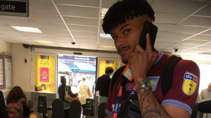 Tyrone Mings arrives at Bournemouth station still in full Aston Villa kit day after playoff win