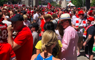 John W. Henry parties with Liverpool fans in Champions League final fan park