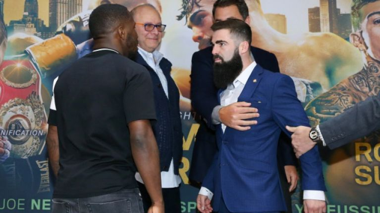 Jono Carroll had to be held back after fiery staredown with Tevin Farmer