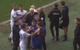 Leeds United's Mateusz Klich squirts water down opponent's back during melee