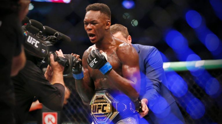 Israel Adesanya picks Robert Whittaker apart to become middleweight champion