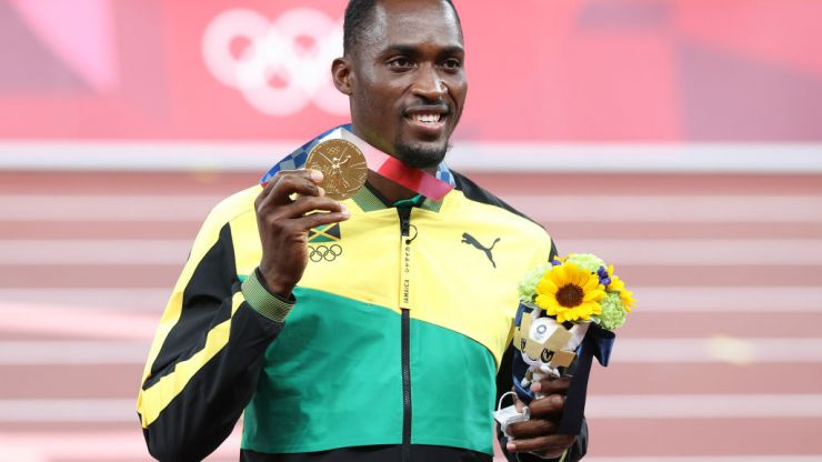 Jamaican gold medalist tracks down volunteer who gave him taxi money to Olympic race